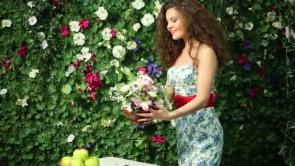 Beautiful woman with bunch of flowers