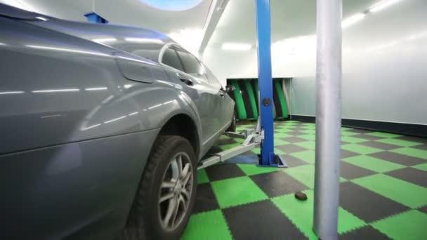 Car lifted for diagnostics and repair