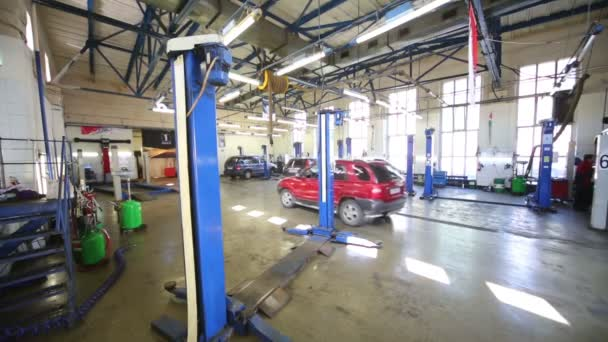 Red car drives in workshop
