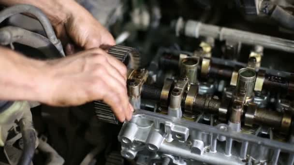 mechanic repairing gasoline car engine