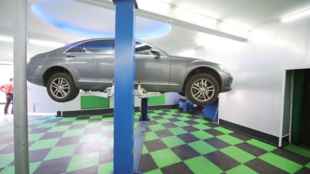 Lifted car waits diagnostics and repair