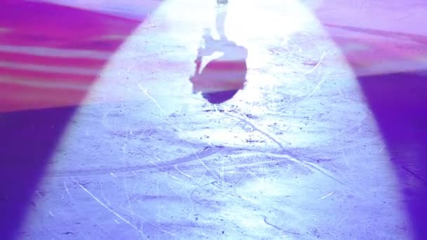 Colored shadow of girl figure skating