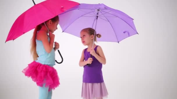 Two girls with colored umbrellas