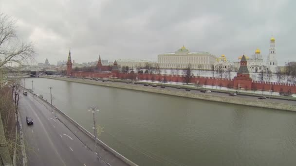 Cars ride by quay of Moskva river