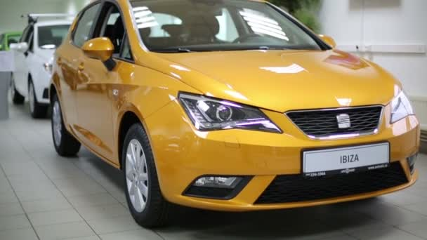 New yellow car in dealership Avtomir