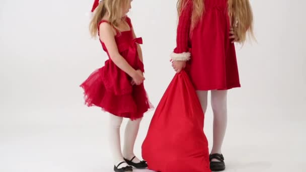 Two girls with bag of gifts
