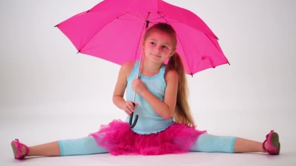 Cute little girl spinning umbrella