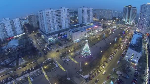 City traffic on boulevard and christmas tree