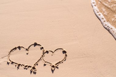 Hearts drawn on beach
