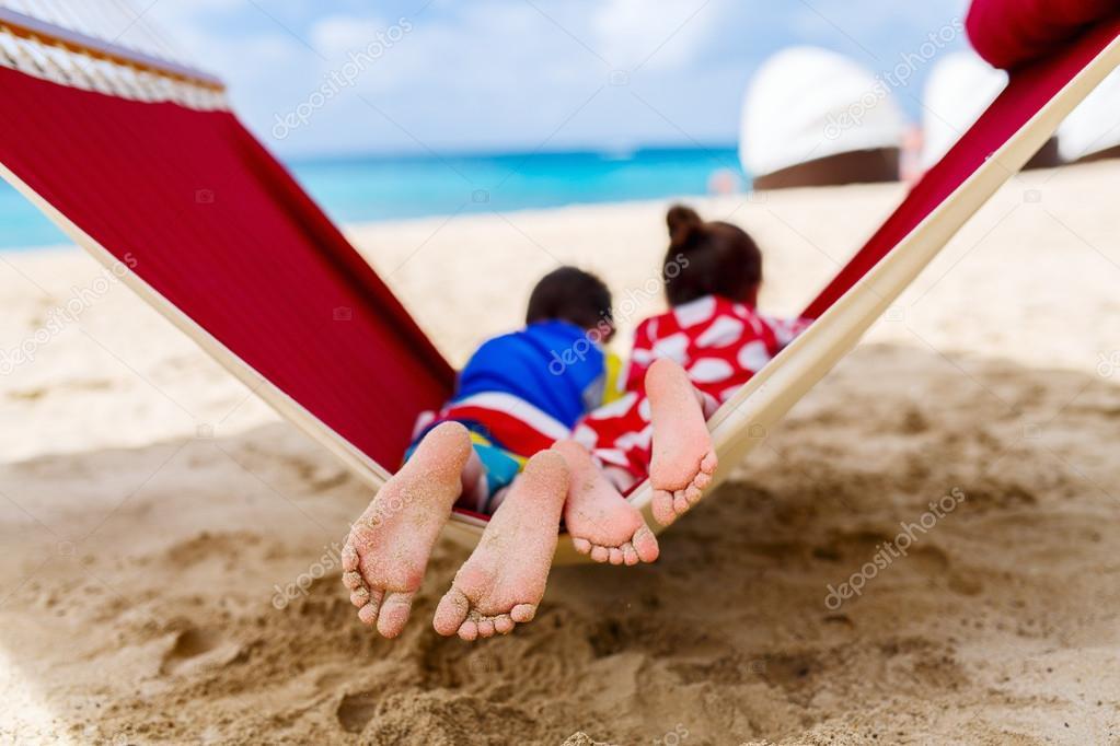 Kids relaxing in hammock