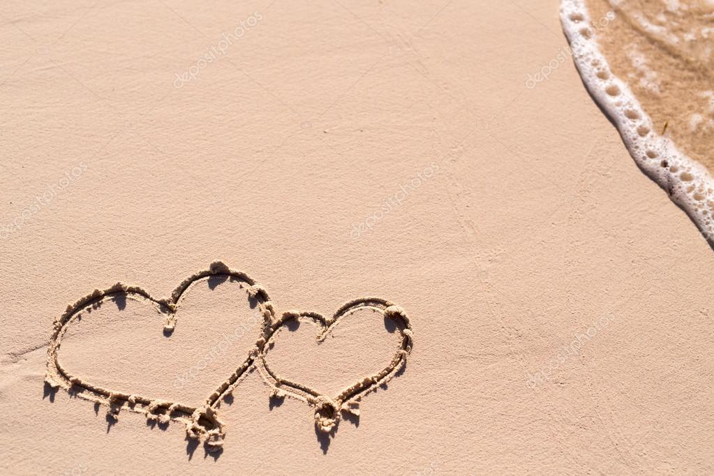 Hearts drawn on beach