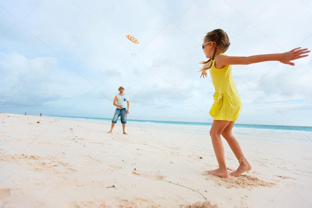 Father and daughter playing with flying disk