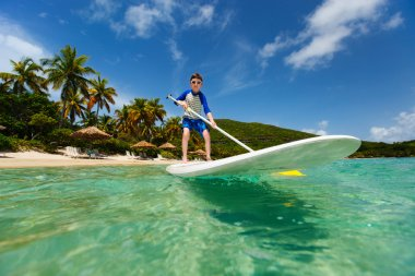 Little boy on stand up paddle board