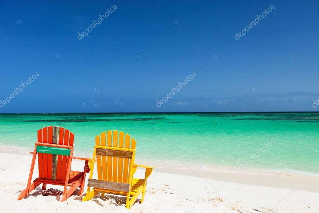 Colorful adirondack lounge chairs at Caribbean beach — Stock ...