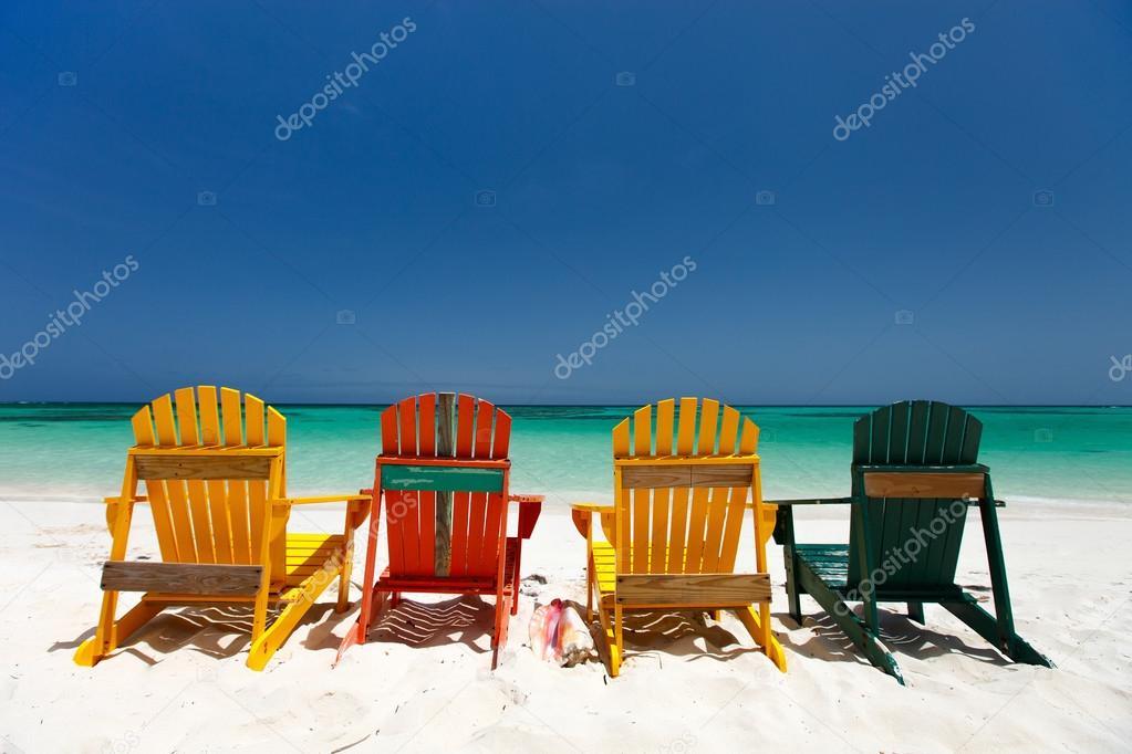 Colorful chairs on Caribbean beach — Stock Photo © shalamov ...