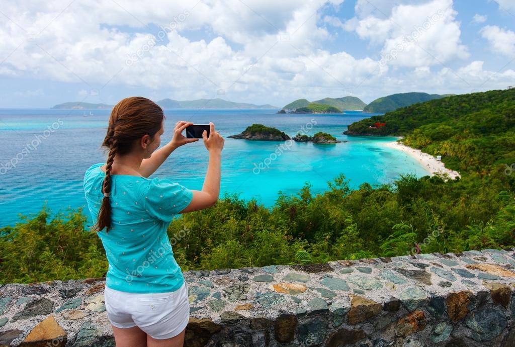 Tourist girl at Trunk bay on St John island