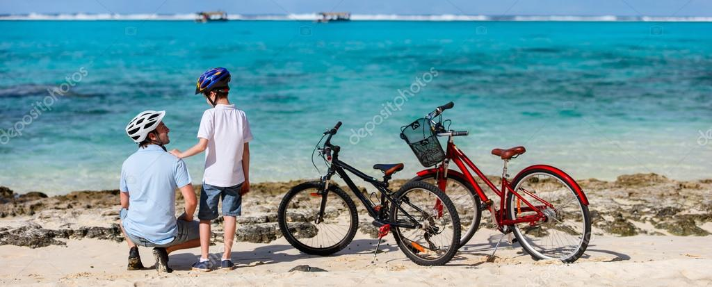 Father and kids at beach with bikes