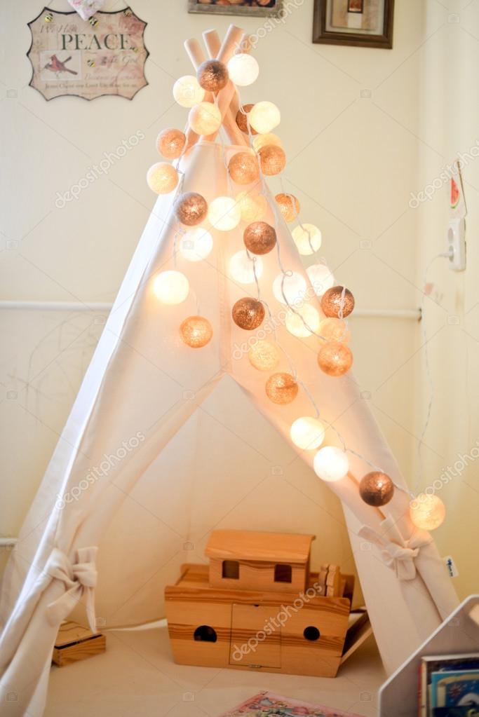 Beautiful fairy lights in a nursery — Stock Photo