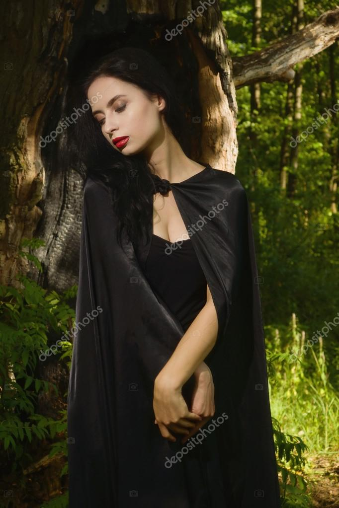 Beautiful Brunette Woman In Black Dress And Cloak The Magic Forest Gothic Style Photo By Demian