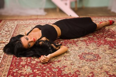 Sensual unconscious woman lying on the floor