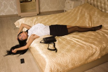Strangled victim in a vintage bedroom