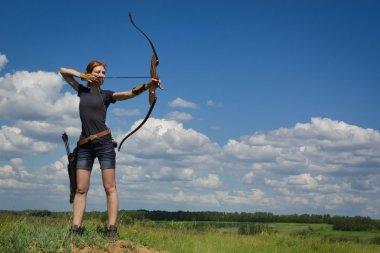 Archery woman bends bow archer target narrow