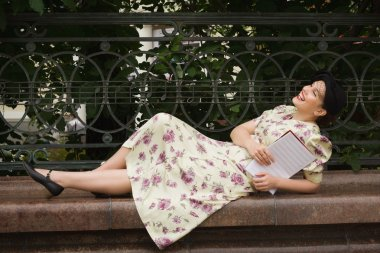 Very beautiful soviet girl in retro style with a music book