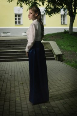 Russian woman in retro style posing on the street.