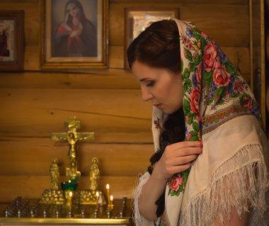 Russian woman praying in church