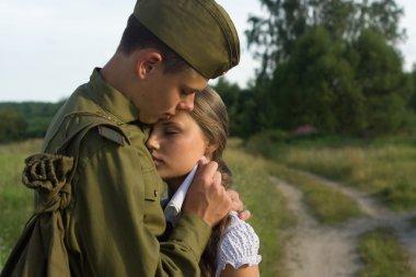 Soviet soldier saying goodbye to girl