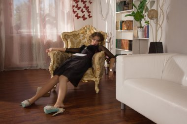 Lifeless woman lying in a boudoir
