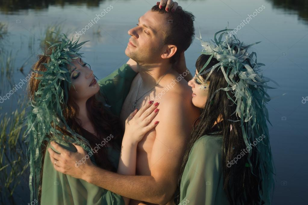 Love between men and two beautiful mermaids