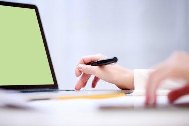 Woman analyzing something at laptop.