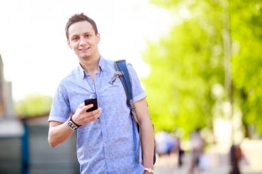 Close up portrait of a young man with phone