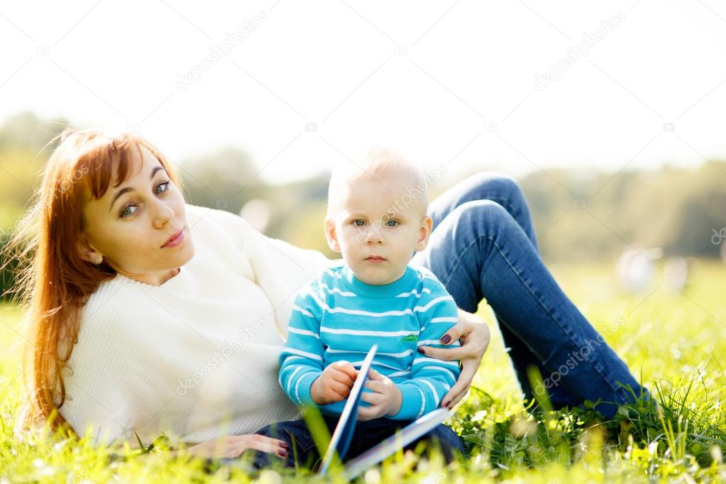 Mother with boy reading book