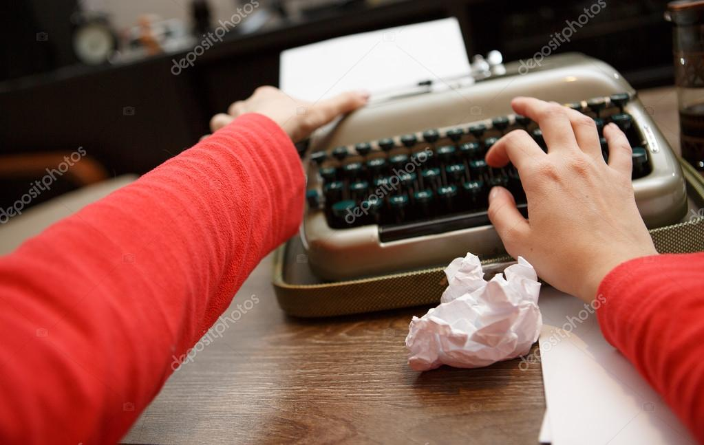 woman working on typewriter