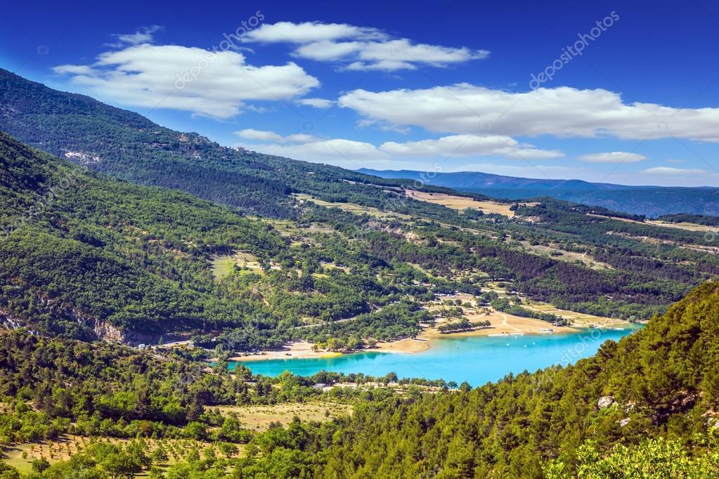 lake among wooded hills