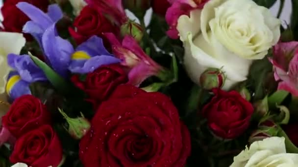 Beautiful bouquet roses, iris and alstroemeria quickly rotating.