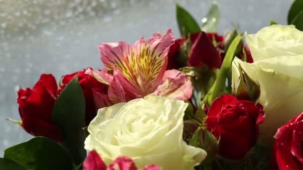 Beautiful bouquet roses, iris and alstroemeria rotates.