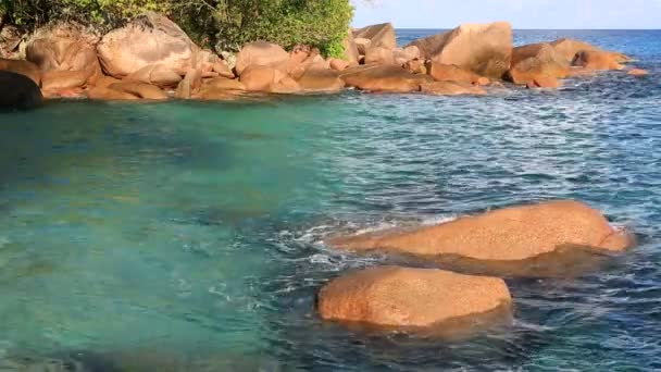 Beautiful granite boulders in Indian Ocean on the beach of Anse Lazio.