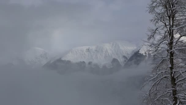 Beautiful mountain peaks of Caucasus Mountains in the clouds. Time Lapse