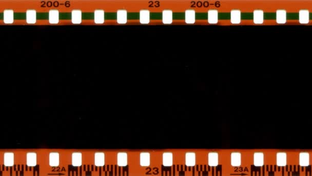 35mm film advancing.