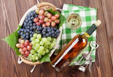 grapes, white wine and corkscrew