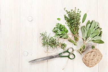 Fresh garden herbs on wooden table