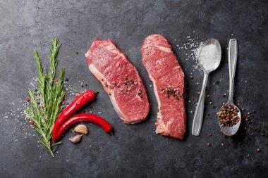Raw striploin steaks