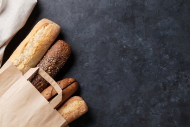 Mixed breads on stone table