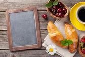 Fotografie Blackboard, croissants and coffee