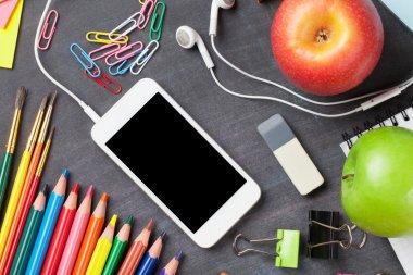 School supplies and smartphone