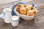 Fotografie Fresh croissants and milk