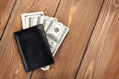 Money cash wallet on wooden table
